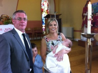 Ava May with her parents, Louise and Declan and her brother Kelan on the day of her baptism.
