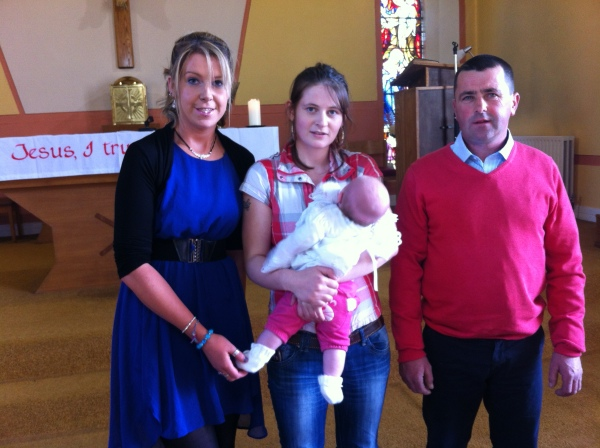 Nicole with her mother Caitriona and her godparents Aisling Donnellan and John Normoyle on her baptism day.