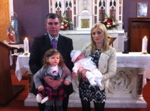 Cian with his parents Bernie and Albert Stephens and sister Nicole on his baptism day.