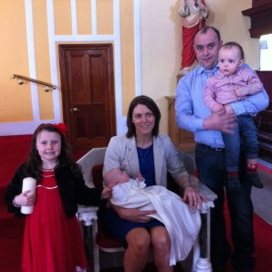 Dáire with his parents Agnes and Gerard, his sister Michelle and brother Stephen on his baptism day.