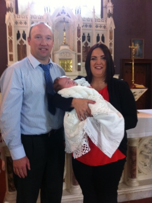 Timmy with his parents Sinead and John on his baptism day.