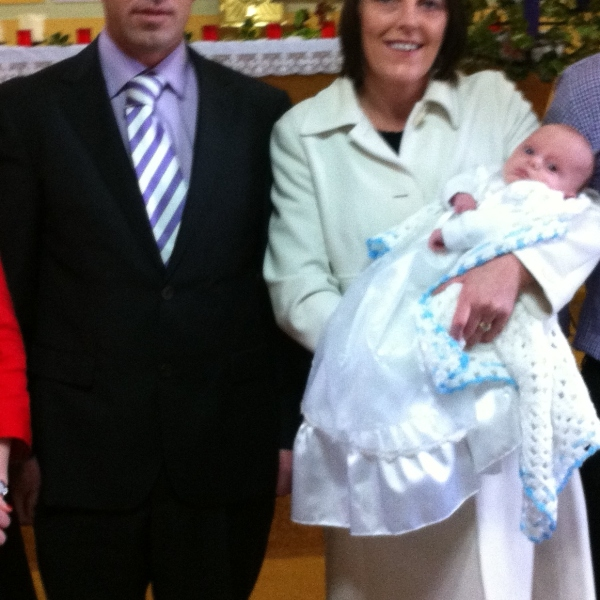 Paraic Meaney with his parents on his baptism day.