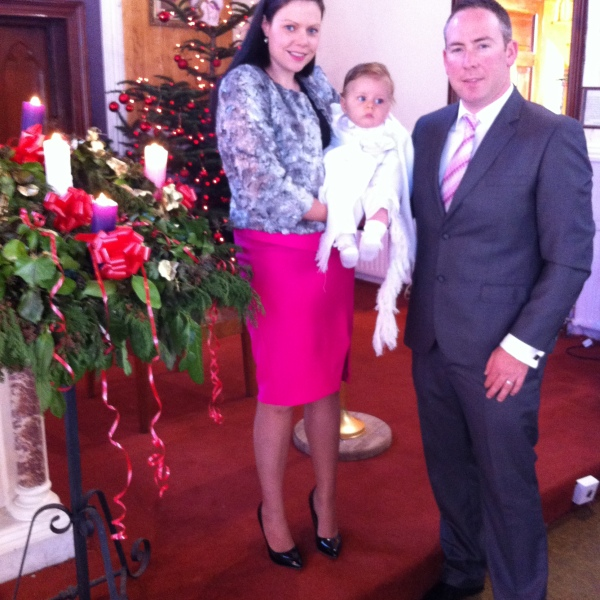 Ryan with his parents in his baptism day.
