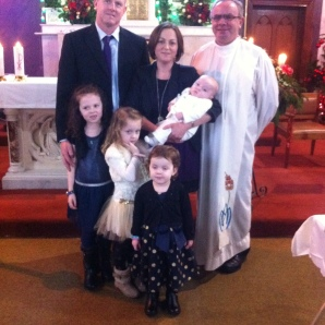 Charlie with his parents and his sisters Ciara, Emma and Rachel on his baptism day.