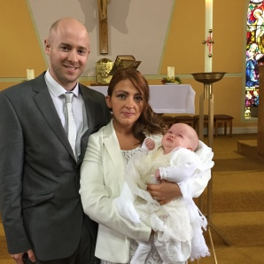 Ruby with her parents on her baptism day.