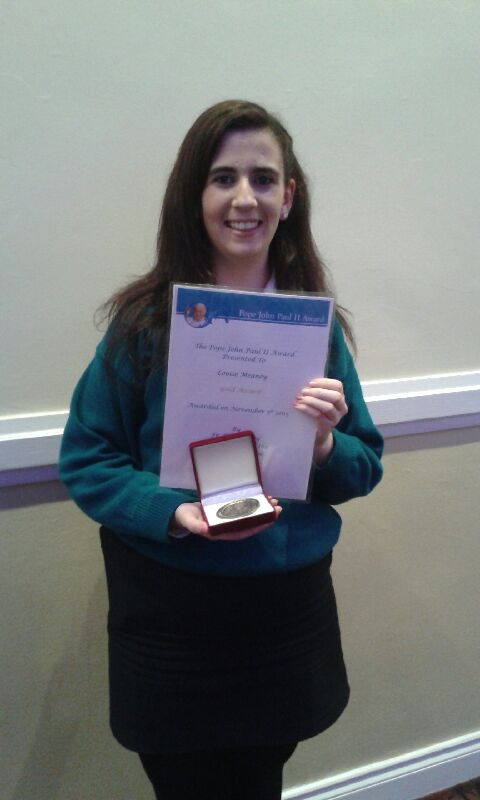 Louise receiving her award.