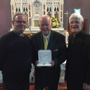 Christy O Connor with Fr Albert McDonnell and Fr Michael O Grady after the presentation.