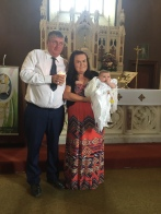 April Patricia with her parents Ciara and Wayne on her baptism day.