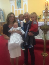 Tadhg with his parents Eimear and Seamus and his brothers Liam and Oisin on his baptism day.