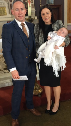Jake with his parents Martina and Colm on his baptism day, 9 October, 2016
