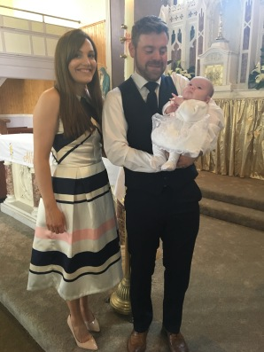 Amelia Annie Corry with her parents Aoife and Alan on her baptism day.