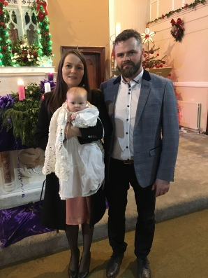 Saoirse Evelynn Cleary with her parents Emma and Michael oh her bsptidm dsy.