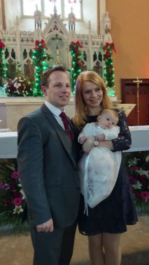 Doireann Lily O'Connell on her baptism day witn her parents Stephanie and Gareth.