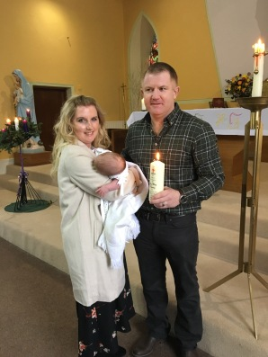 Tess May Keavey on her baptism day with her parents Julia and Anthony.