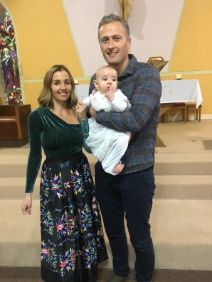 Evan Michael O'Sullivan with his parents on his baptism day.