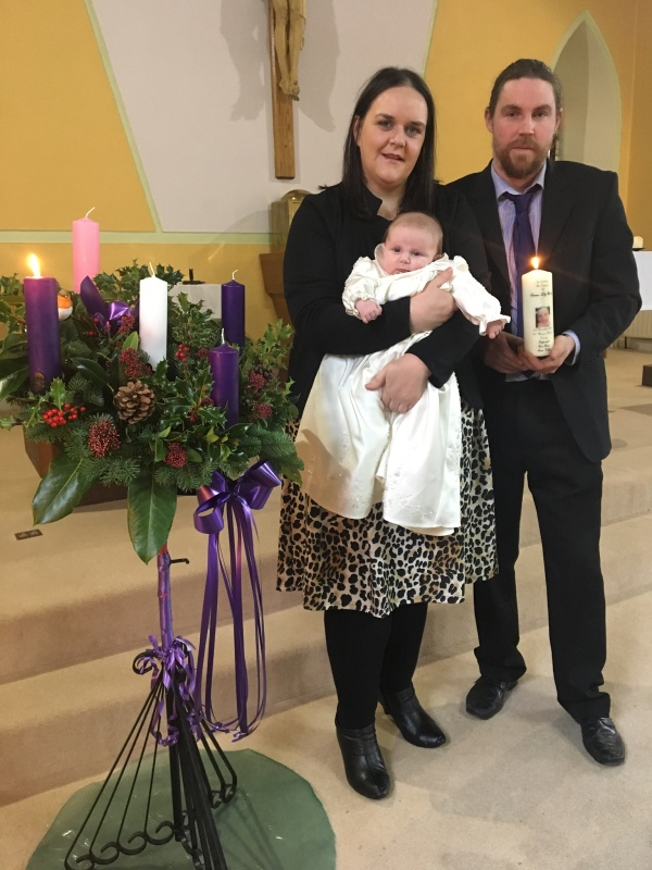 Emma Lily Quinn with her parents Sheila and Seamus on her baptism day.