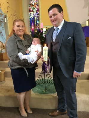 Jake Lucas with his parents Niamh and Maurice on his baptism day.